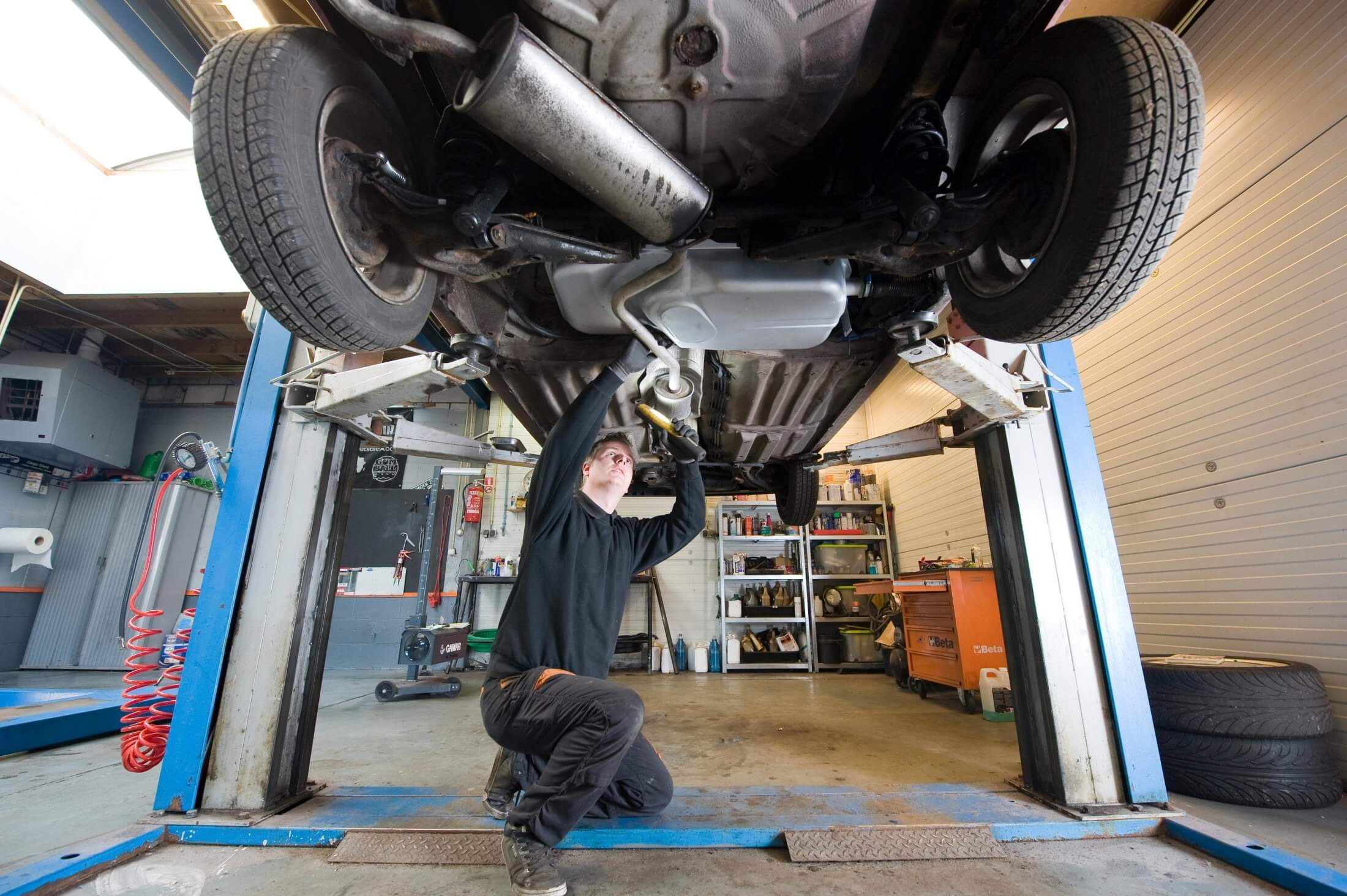 Mechanic Servicing Car